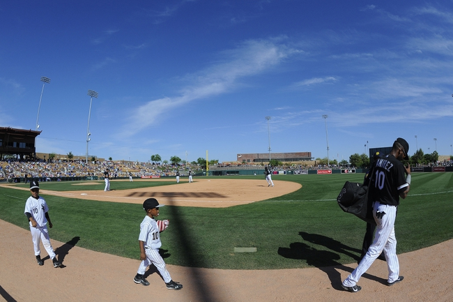 Mar 21, 2014; Phoenix, AZ, USA; Chicago White Sox shortstop Alexei Ramirez (10) leaves the game with his two children against the Chicago Cubs at Camelback Ranch. The Cubs won 7-0. Mandatory Credit: Joe Camporeale-USA TODAY Sports