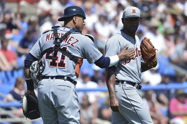 Mar 22, 2014; Dunedin, FL, USA; Detroit Tigers designated hitter Victor Martinez (41) talks with pitcher Jahn Marinez (66) on the mound during the fourth inning against the Toronto Blue Jays at Florida Auto Exchange Park. Mandatory Credit: Tommy Gilligan-USA TODAY Sports