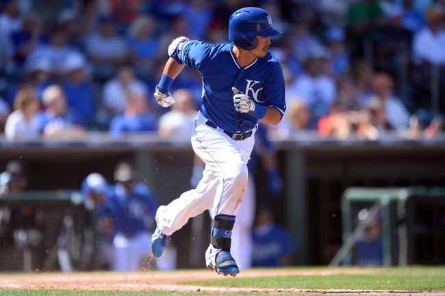 Mar 22, 2014; Surprise, AZ, USA; Kansas City Royals right fielder Norichika Aoki (23) runs to first base after making contact against the Texas Rangers at Surprise Stadium. Mandatory Credit: Joe Camporeale-USA TODAY Sports