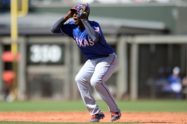 Mar 22, 2014; Surprise, AZ, USA; Texas Rangers second baseman Jurickson Profar (13) reacts after Kansas City Royals shortstop Alcides Escobar (not pictured) was called safe at second base with a double at Surprise Stadium. Mandatory Credit: Joe Camporeale-USA TODAY Sports