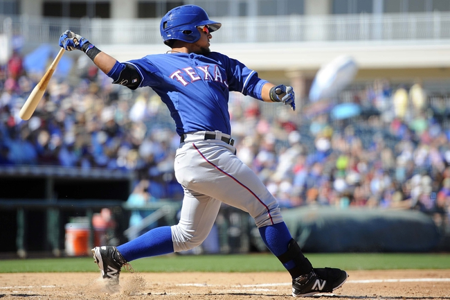 Mar 22, 2014; Surprise, AZ, USA; Texas Rangers infielder Rougned Odor (73) hits an RBI double in the seventh inning against the Texas Rangers at Surprise Stadium. The Royals won 8-4. Mandatory Credit: Joe Camporeale-USA TODAY Sports