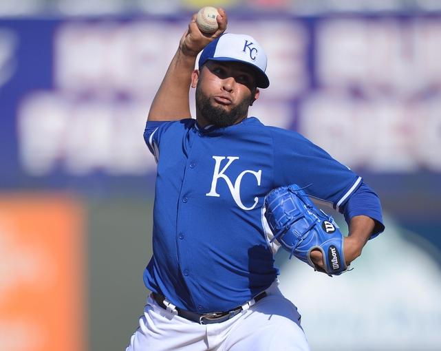 Mar 22, 2014; Surprise, AZ, USA; Kansas City Royals relief pitcher Kelvin Herrera (40) pitches in the ninth inning against the Texas Rangers at Surprise Stadium. The Royals won 8-4. Mandatory Credit: Joe Camporeale-USA TODAY Sports