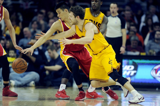 Mar 22, 2014; Cleveland, OH, USA; Houston Rockets guard Jeremy Lin (7) and Cleveland Cavaliers guard Matthew Dellavedova (8) go for a loose ball during the second quarter at Quicken Loans Arena. Mandatory Credit: Ken Blaze-USA TODAY Sports