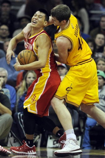 Mar 22, 2014; Cleveland, OH, USA; Cleveland Cavaliers center Tyler Zeller (40) fouls Houston Rockets guard Jeremy Lin (7) during the second quarter at Quicken Loans Arena. Mandatory Credit: Ken Blaze-USA TODAY Sports