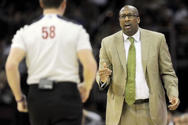 Mar 22, 2014; Cleveland, OH, USA; Cleveland Cavaliers head coach Mike Brown argues a call with referee Josh Tiven (58) during the second quarter against the Houston Rockets at Quicken Loans Arena. Mandatory Credit: Ken Blaze-USA TODAY Sports