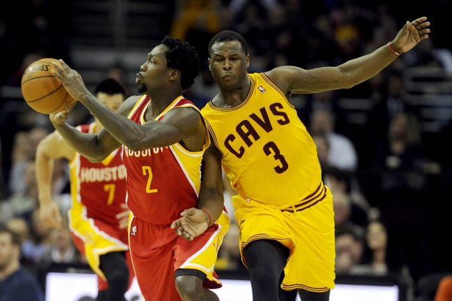 Mar 22, 2014; Cleveland, OH, USA; Houston Rockets guard Patrick Beverley (2) grabs a loose ball ahead of Cleveland Cavaliers guard Dion Waiters (3) during the second quarter at Quicken Loans Arena. Mandatory Credit: Ken Blaze-USA TODAY Sports
