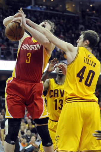 Mar 22, 2014; Cleveland, OH, USA; Cleveland Cavaliers center Tyler Zeller (40) fouls Houston Rockets center Omer Asik (3) during the second quarter at Quicken Loans Arena. Mandatory Credit: Ken Blaze-USA TODAY Sports
