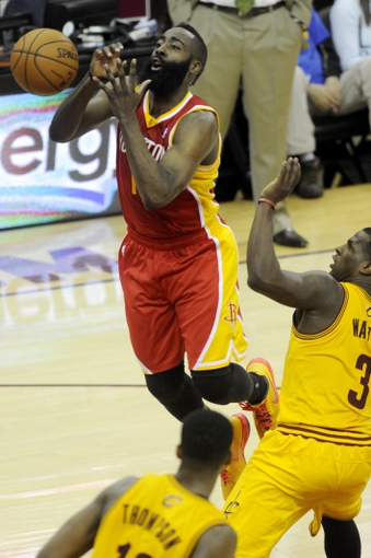 Mar 22, 2014; Cleveland, OH, USA; Houston Rockets guard James Harden (13) loses the ball as he drives for the basket against the Cleveland Cavaliers during the third quarter at Quicken Loans Arena. Houston won 118-111. Mandatory Credit: Ken Blaze-USA TODAY Sports