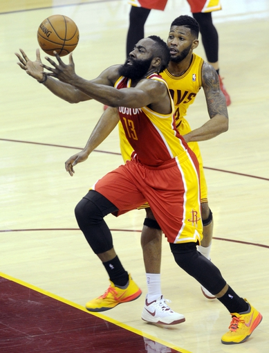 Mar 22, 2014; Cleveland, OH, USA; Houston Rockets guard James Harden (13) drives to the basket during the third quarter at Quicken Loans Arena. Houston won 118-111. Mandatory Credit: Ken Blaze-USA TODAY Sports