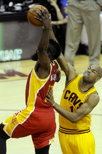 Mar 22, 2014; Cleveland, OH, USA; Cleveland Cavaliers guard Jarrett Jack (1) tries to block the dunk of Houston Rockets guard James Harden (13) during the third quarter at Quicken Loans Arena. Houston won 118-111. Mandatory Credit: Ken Blaze-USA TODAY Sports