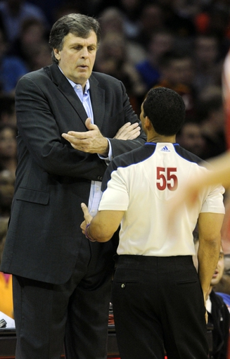 Mar 22, 2014; Cleveland, OH, USA; Houston Rockets head coach Kevin McHale talks with referee Bill Kennedy (55) during the third quarter against the Cleveland Cavaliers at Quicken Loans Arena. Houston won 118-111. Mandatory Credit: Ken Blaze-USA TODAY Sports