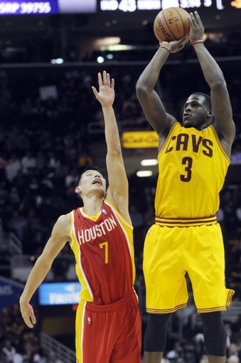 Mar 22, 2014; Cleveland, OH, USA; Cleveland Cavaliers guard Dion Waiters (3) shoots on Houston Rockets guard Jeremy Lin (7) during the fourth quarter at Quicken Loans Arena. Houston won 118-111. Mandatory Credit: Ken Blaze-USA TODAY Sports