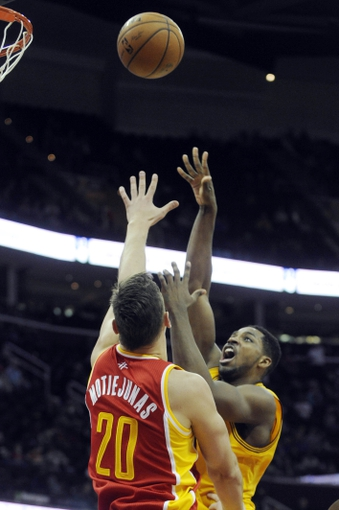 Mar 22, 2014; Cleveland, OH, USA; Cleveland Cavaliers forward Tristan Thompson (13) shoots over Houston Rockets forward Donatas Motiejunas (20) during the fourth quarter at Quicken Loans Arena. Houston won 118-111. Mandatory Credit: Ken Blaze-USA TODAY Sports