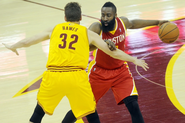 Mar 22, 2014; Cleveland, OH, USA; Houston Rockets guard James Harden (13) works against Cleveland Cavaliers center Spencer Hawes (32) during the third quarter at Quicken Loans Arena. Houston won 118-111. Mandatory Credit: Ken Blaze-USA TODAY Sports