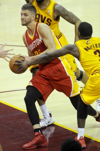 Mar 22, 2014; Cleveland, OH, USA; Houston Rockets forward Chandler Parsons (25) drives to the basket past Cleveland Cavaliers guard Dion Waiters (3) during the third quarter at Quicken Loans Arena. Houston won 118-111. Mandatory Credit: Ken Blaze-USA TODAY Sports