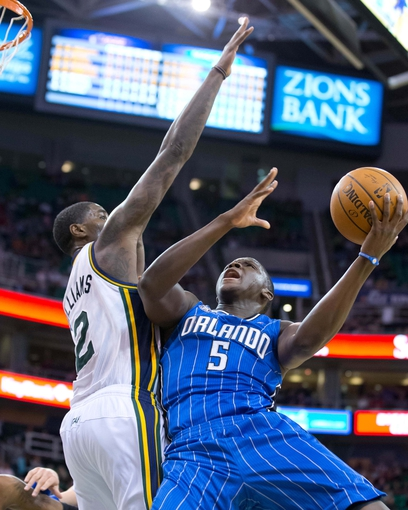 Mar 22, 2014; Salt Lake City, UT, USA; Orlando Magic guard Victor Oladipo (5) shoots against Utah Jazz forward Marvin Williams (2) during the first half at EnergySolutions Arena. Mandatory Credit: Russ Isabella-USA TODAY Sports