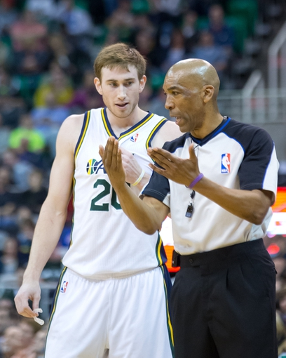 Mar 22, 2014; Salt Lake City, UT, USA; Utah Jazz guard Gordon Hayward (20) talks with referee Leon Wood (40) during the first half against the Orlando Magic at EnergySolutions Arena. Mandatory Credit: Russ Isabella-USA TODAY Sports