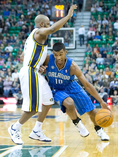 Mar 22, 2014; Salt Lake City, UT, USA; Orlando Magic guard Ronnie Price (10) attempts to dribble around Utah Jazz guard John Lucas III (5) during the first half at EnergySolutions Arena. Mandatory Credit: Russ Isabella-USA TODAY Sports