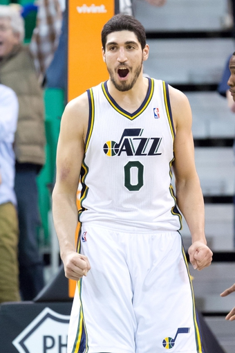 Mar 22, 2014; Salt Lake City, UT, USA; Utah Jazz center Enes Kanter (0) reacts to defeating the Orlando Magic 89-88 at EnergySolutions Arena. Mandatory Credit: Russ Isabella-USA TODAY Sports