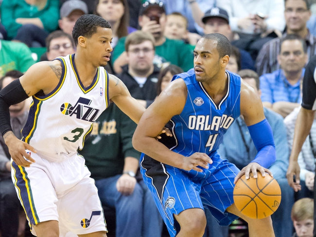 Mar 22, 2014; Salt Lake City, UT, USA; Utah Jazz guard Trey Burke (3) defends against Orlando Magic guard Arron Afflalo (4) during the second half at EnergySolutions Arena. The Jazz won 89-88. Mandatory Credit: Russ Isabella-USA TODAY Sports