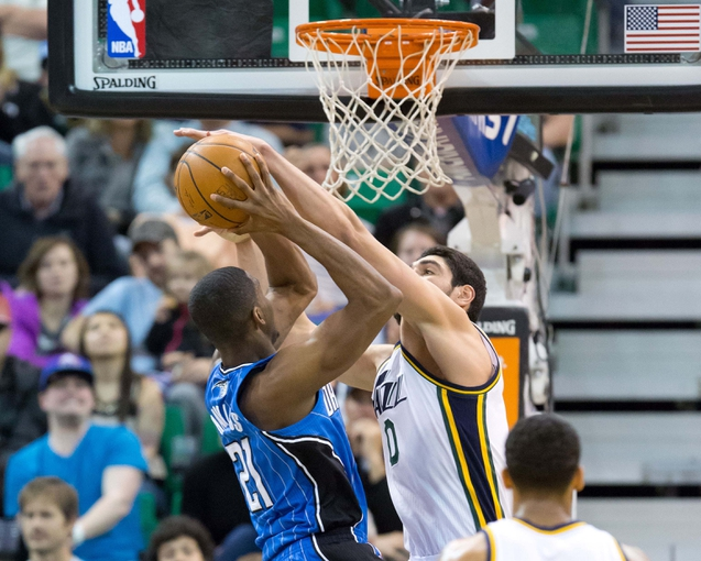 Mar 22, 2014; Salt Lake City, UT, USA; Utah Jazz center Enes Kanter (0) blocks the shot of Orlando Magic forward Maurice Harkless (21) during the second half at EnergySolutions Arena. The Jazz won 89-88. Mandatory Credit: Russ Isabella-USA TODAY Sports