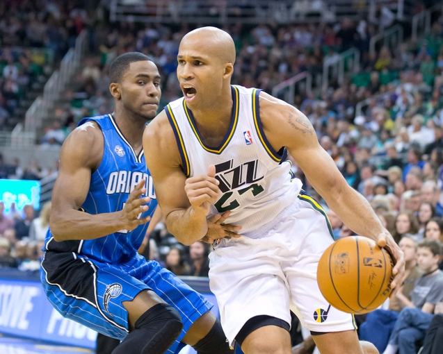 Mar 22, 2014; Salt Lake City, UT, USA; Utah Jazz forward Richard Jefferson (24) dribbles around Orlando Magic forward Maurice Harkless (21) during the second half at EnergySolutions Arena. The Jazz won 89-88. Mandatory Credit: Russ Isabella-USA TODAY Sports