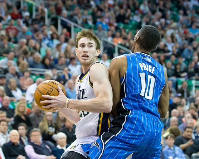 Mar 22, 2014; Salt Lake City, UT, USA; Orlando Magic guard Ronnie Price (10) draws an offensive foul on Utah Jazz guard Gordon Hayward (20) during the second half at EnergySolutions Arena. The Jazz won 89-88. Mandatory Credit: Russ Isabella-USA TODAY Sports