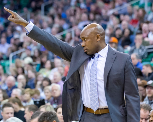 Mar 22, 2014; Salt Lake City, UT, USA; Orlando Magic head coach Jacque Vaughn signals to one of his players during the second half against the Utah Jazz at EnergySolutions Arena. The Jazz won 89-88. Mandatory Credit: Russ Isabella-USA TODAY Sports