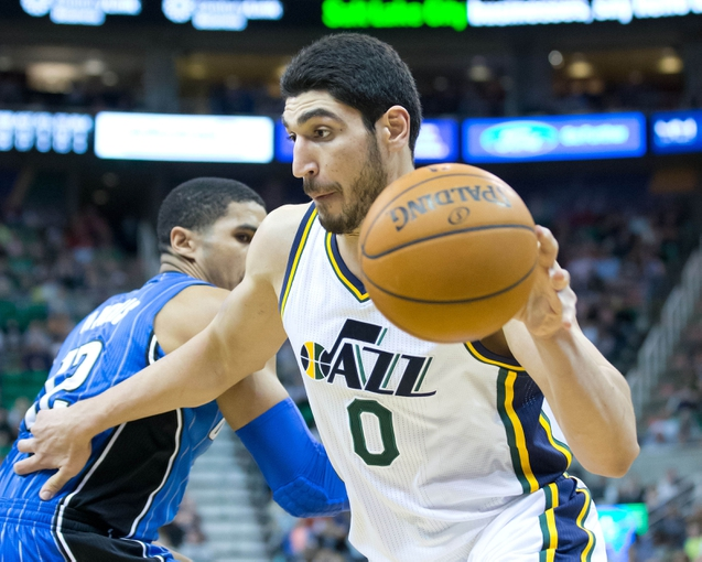 Mar 22, 2014; Salt Lake City, UT, USA; Utah Jazz center Enes Kanter (0) dribbles around Orlando Magic forward Tobias Harris (12) during the second half at EnergySolutions Arena. The Jazz won 89-88. Mandatory Credit: Russ Isabella-USA TODAY Sports