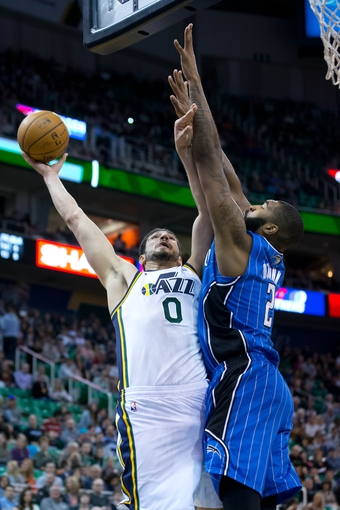 Mar 22, 2014; Salt Lake City, UT, USA; Utah Jazz center Enes Kanter (0) shoots against Orlando Magic forward Kyle O'Quinn (2) during the second half at EnergySolutions Arena. The Jazz won 89-88. Mandatory Credit: Russ Isabella-USA TODAY Sports