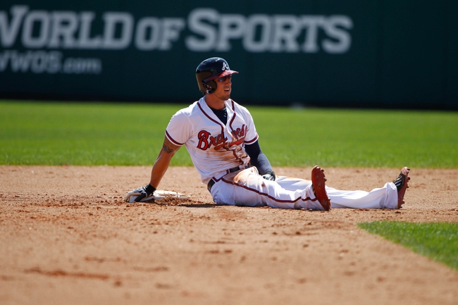 Mar 14, 2014; Lake Buena Vista, FL, USA; Atlanta Braves center fielder Jordan Schafer (17) sits on second base after he slid against the Tampa Bay Rays  at Champion Stadium. Mandatory Credit: Kim Klement-USA TODAY Sports