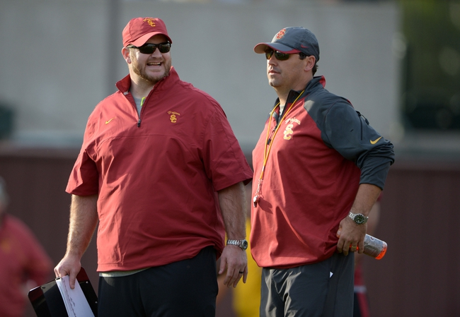 Mar 11, 2014; Los Angeles, CA, USA; Southern California Trojans graduate offensive assistant coach Kyle DeVan (left) and coach Steve Sarkisian at spring practice at Howard Jones Field. Mandatory Credit: Kirby Lee-USA TODAY Sports