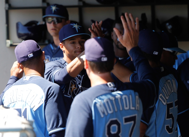 Mar 14, 2014; Lake Buena Vista, FL, USA; Tampa Bay Rays starting pitcher Chris Archer (22) is congratulated by teammates after he pitched during the fifth inning against the Atlanta Braves at Champion Stadium. Mandatory Credit: Kim Klement-USA TODAY Sports