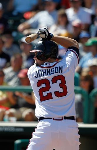 Mar 14, 2014; Lake Buena Vista, FL, USA; Atlanta Braves third baseman Chris Johnson (23) against the Tampa Bay Rays at Champion Stadium. Mandatory Credit: Kim Klement-USA TODAY Sports