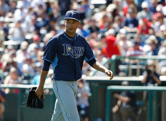 Mar 14, 2014; Lake Buena Vista, FL, USA; Tampa Bay Rays starting pitcher Chris Archer (22) walks back to the dugout after he pitched against the Atlanta Braves at Champion Stadium. Mandatory Credit: Kim Klement-USA TODAY Sports