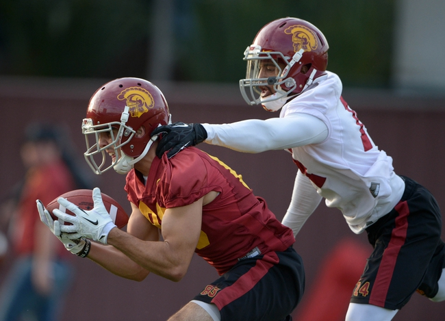 Mar 11, 2014; Los Angeles, CA, USA; Southern California Trojans receiver Christian Tober (28) is defended by cornerback Ryan Henderson (14) at spring practice at Howard Jones Field. Mandatory Credit: Kirby Lee-USA TODAY Sports