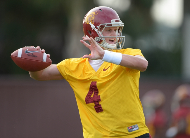 Mar 11, 2014; Los Angeles, CA, USA; Southern California Trojans quarterback Max Browne (4) throws a pass during spring practice at Howard Jones Field. Mandatory Credit: Kirby Lee-USA TODAY Sports