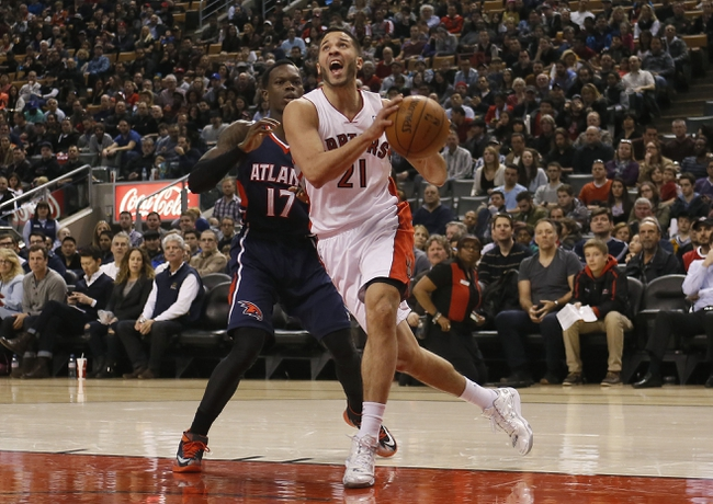 Mar 23, 2014; Toronto, Ontario, CAN; Toronto Raptors guard Greivis Vasquez (21) carries the ball past Atlanta Hawks guard Dennis Schroder (17) during the first half at the Air Canada Centre. Mandatory Credit: John E. Sokolowski-USA TODAY Sports