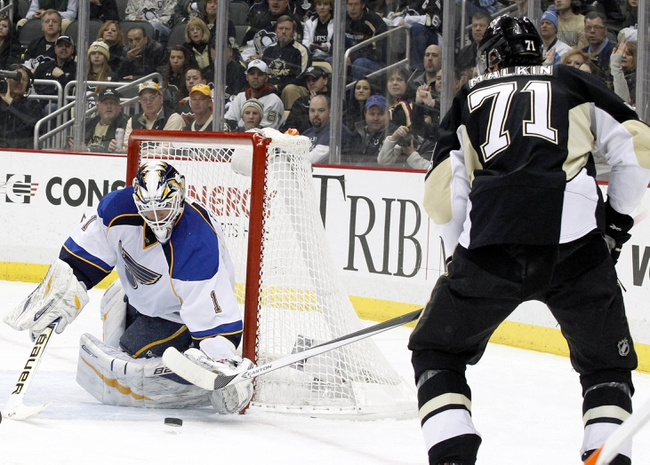 Mar 23, 2014; Pittsburgh, PA, USA; St. Louis Blues goalie Brian Elliott (1) makes a save against Pittsburgh Penguins center Evgeni Malkin (71) during the second period at the CONSOL Energy Center.  The St. Louis Blues won 1-0. Mandatory Credit: Charles LeClaire-USA TODAY Sports