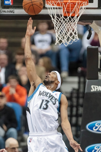 Mar 23, 2014; Minneapolis, MN, USA; Minnesota Timberwolves forward Corey Brewer (13) shoots in the first quarter against the Phoenix Suns at Target Center. Mandatory Credit: Brad Rempel-USA TODAY Sports