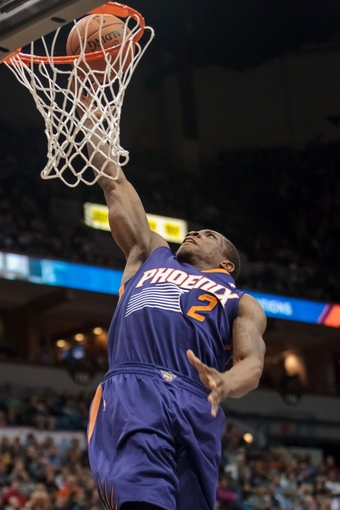 Mar 23, 2014; Minneapolis, MN, USA; Phoenix Suns guard Eric Bledsoe (2) shoots in the second quarter against the Minnesota Timberwolves at Target Center. Mandatory Credit: Brad Rempel-USA TODAY Sports