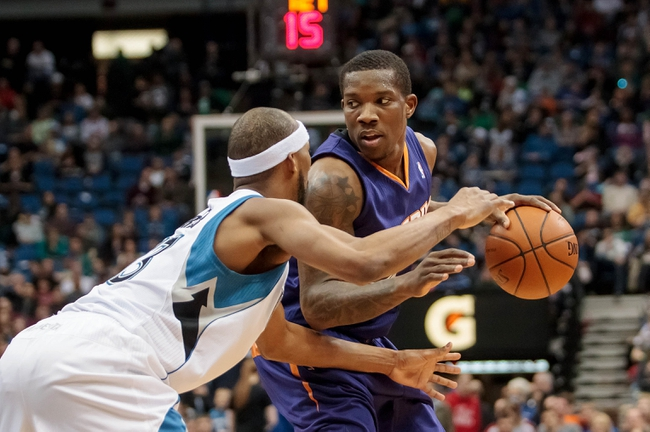 Mar 23, 2014; Minneapolis, MN, USA; Phoenix Suns guard Eric Bledsoe (2) dribbles in the second quarter against the Minnesota Timberwolves forward Corey Brewer (13) at Target Center. Mandatory Credit: Brad Rempel-USA TODAY Sports