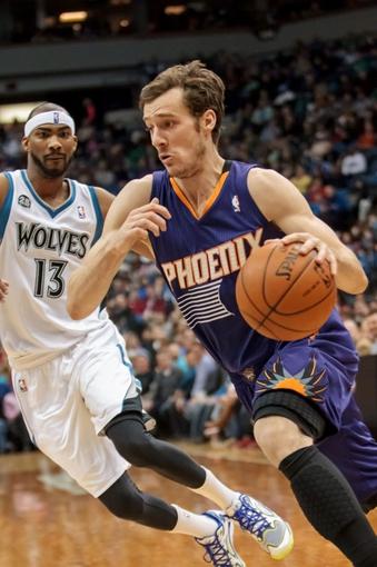 Mar 23, 2014; Minneapolis, MN, USA; Phoenix Suns guard Goran Dragic (1) dribbles in the second quarter against the Minnesota Timberwolves at Target Center. Mandatory Credit: Brad Rempel-USA TODAY Sports