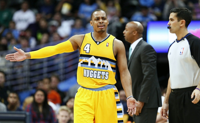 Mar 23, 2014; Denver, CO, USA; Denver Nuggets point guard Randy Foye (4) reacts to a call in the second quarter against the Washington Wizards at the Pepsi Center. Mandatory Credit: Isaiah J. Downing-USA TODAY Sports