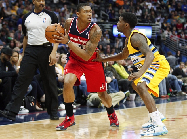 Mar 23, 2014; Denver, CO, USA; Denver Nuggets point guard Aaron Brooks (0) guards Washington Wizards shooting guard Bradley Beal (3) in the second quarter at the Pepsi Center. Mandatory Credit: Isaiah J. Downing-USA TODAY Sports