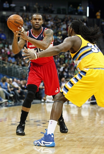 Mar 23, 2014; Denver, CO, USA; Denver Nuggets small forward Kenneth Faried (35) guards Washington Wizards power forward Trevor Booker (35) in the second quarter at the Pepsi Center. Mandatory Credit: Isaiah J. Downing-USA TODAY Sports