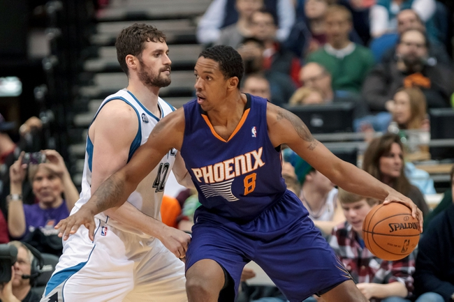 Mar 23, 2014; Minneapolis, MN, USA; Phoenix Suns forward Channing Frye (8) dribbles in the third quarter against the Minnesota Timberwolves forward Kevin Love (42) at Target Center. Phoenix wins 127-120. Mandatory Credit: Brad Rempel-USA TODAY Sports