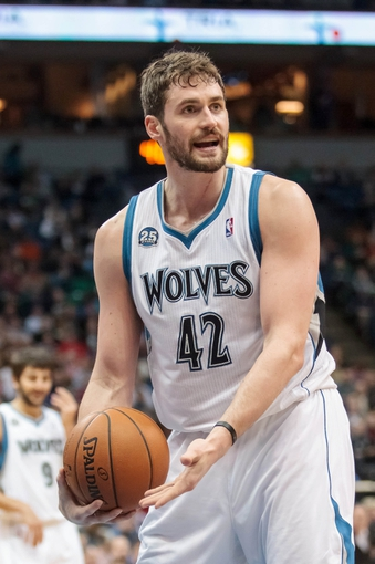 Mar 23, 2014; Minneapolis, MN, USA; Minnesota Timberwolves forward Kevin Love (42) talks to the referee in the third quarter against the Phoenix Suns at Target Center. Phoenix wins 127-120. Mandatory Credit: Brad Rempel-USA TODAY Sports