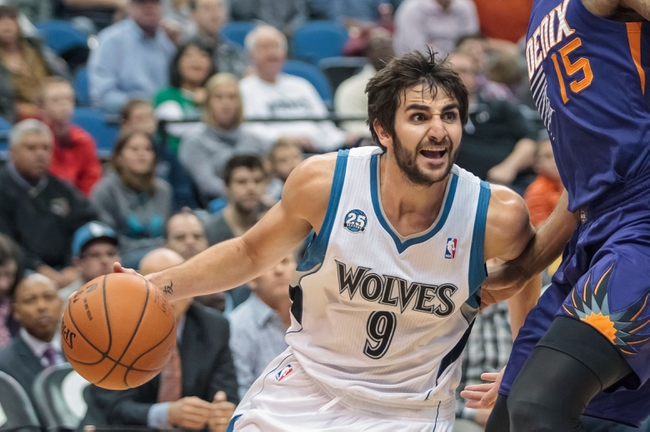 Mar 23, 2014; Minneapolis, MN, USA; Minnesota Timberwolves guard Ricky Rubio (9) dribbles in the fourth quarter against the Phoenix Suns at Target Center. Phoenix wins 127-120. Mandatory Credit: Brad Rempel-USA TODAY Sports