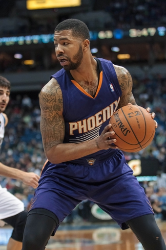 Mar 23, 2014; Minneapolis, MN, USA; Phoenix Suns forward Markieff Morris (11) dribbles against the Minnesota Timberwolves in the third quarter at Target Center. Phoenix wins 127-120. Mandatory Credit: Brad Rempel-USA TODAY Sports